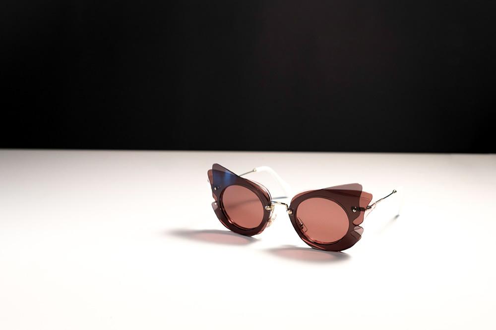 Ružové Miu Miu slnečné okuliare s rámom v ružovej farbe 4b6a45c9506