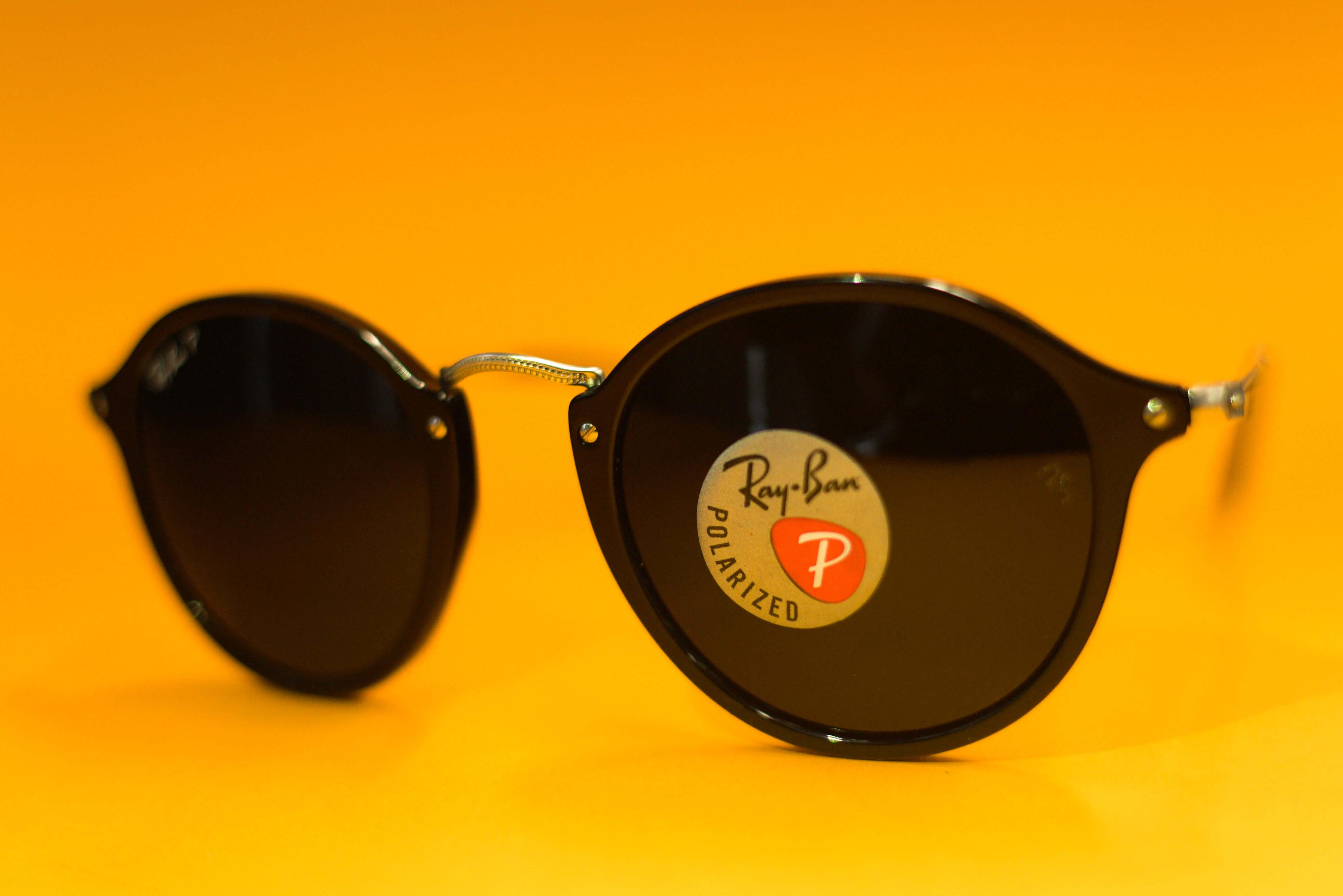 73e612ee69 Ray-Ban products also include a high quality sticker with Ray-Ban logo that  sticks to the lens by static. Any signs of glue under the sticker may  indicate ...