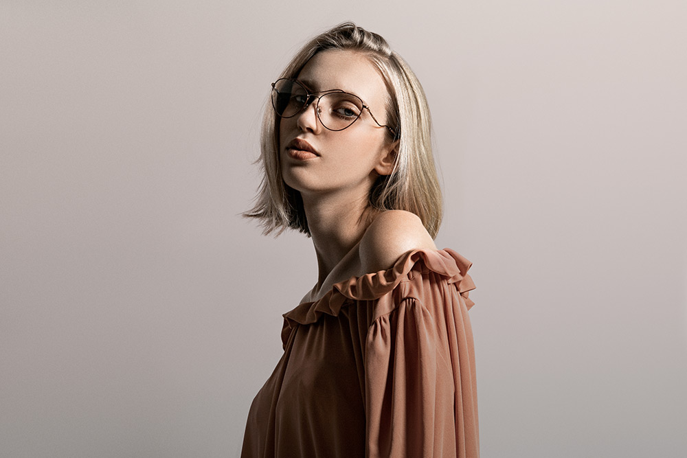 Natália Pažická wears aviator prescription glasses Miu Miu