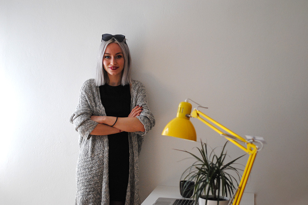 eyerim office tour, creative office, Andrea the creative director wearing Max&Co Sunglasses in Black