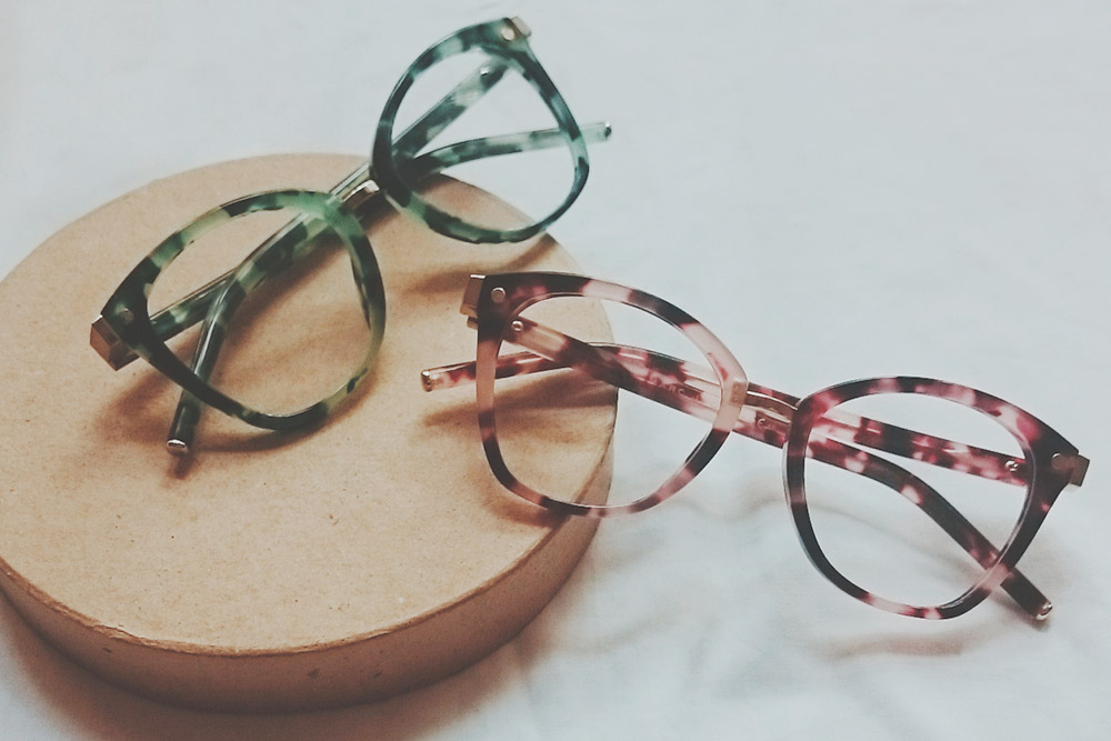 Benefits of shopping prescription glasses online, Prada prescription glasses on eyerim, eyerim flatlay